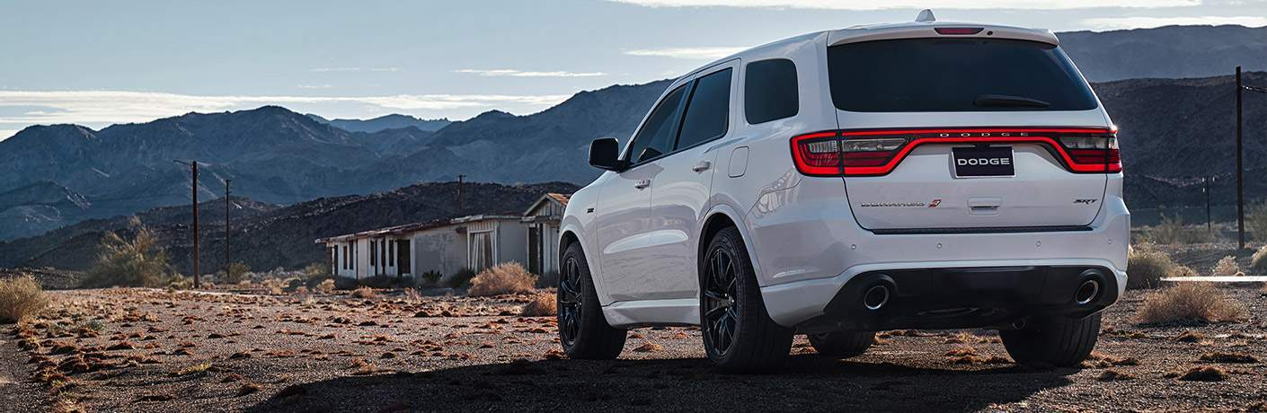 2018 Dodge Durano in white parked near an abandoned building in the desert