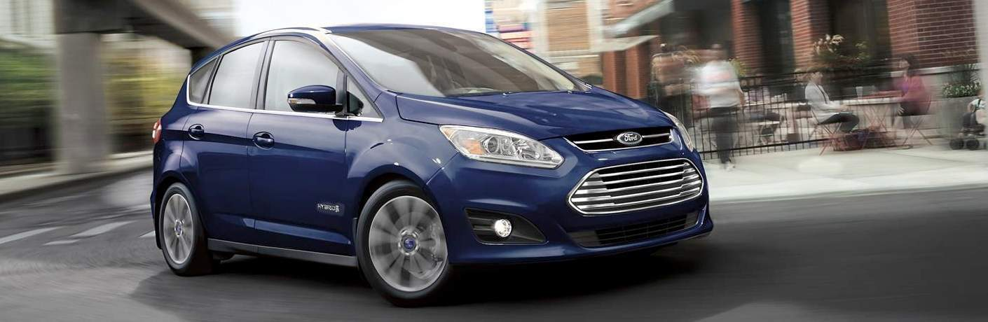 2018 Ford C-Max Hybrid in blue turning the corner on a city street