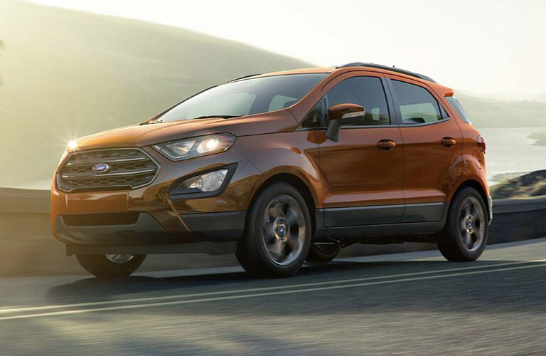2018 Ford EcoSport in orange driving at sunset