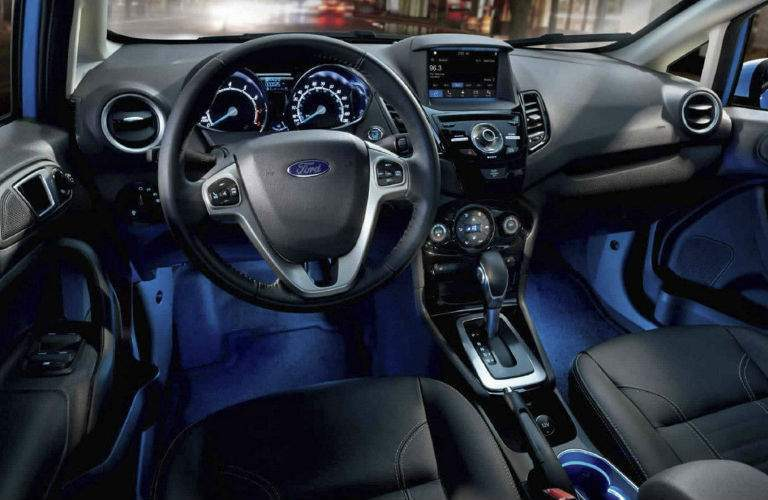 2018 Ford Fiesta steering wheel and dashboard with blue ambient lighting