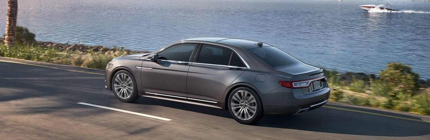 2018 Lincoln Continental in grey driving along a waterfront road