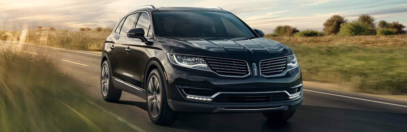 2018 Lincoln MKX in black driving on a country road