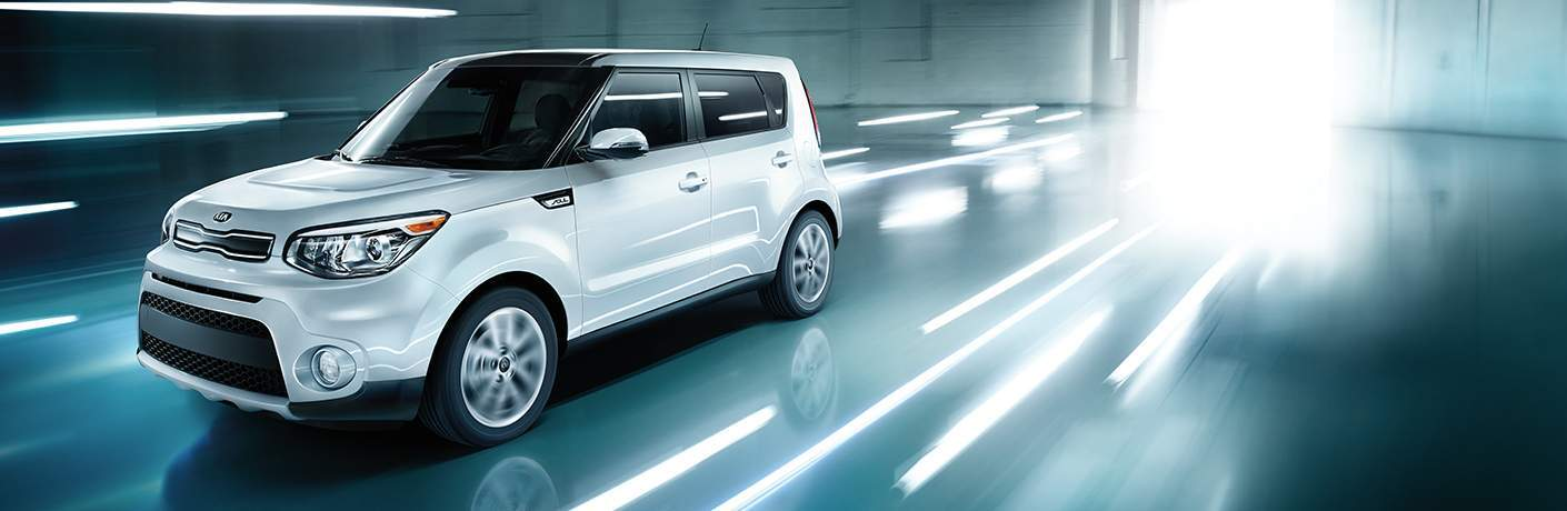 2018 Kia Soul exterior in white sitting in a blurry showroom