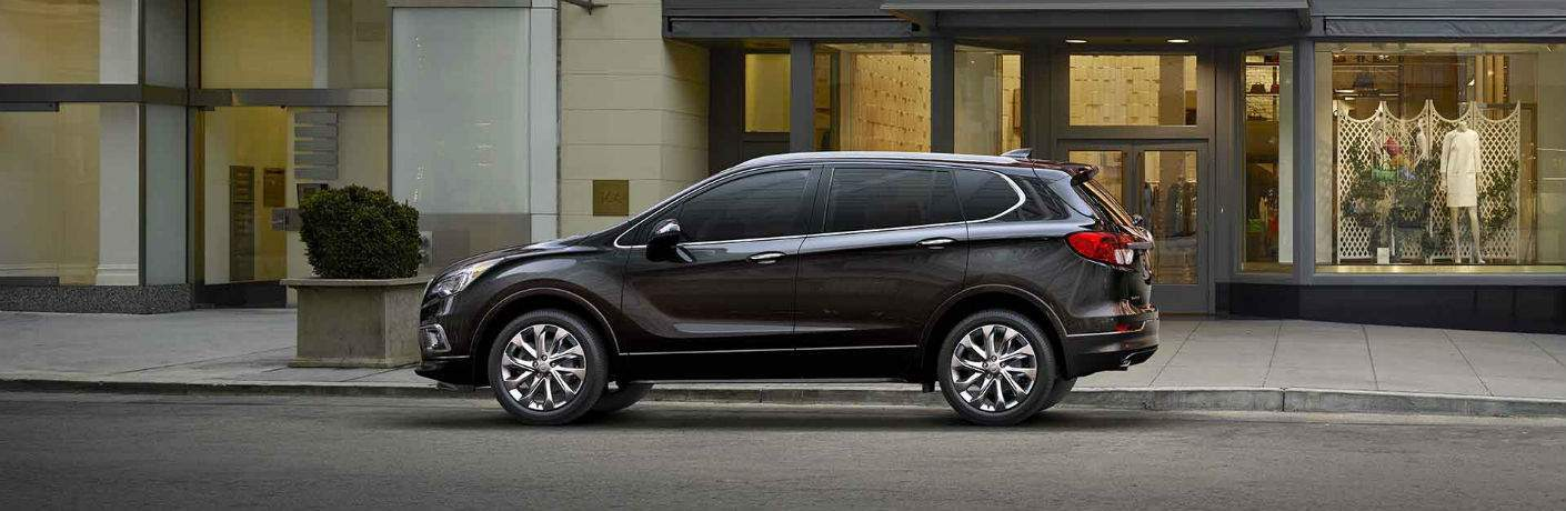 2018 Buick Envision in grey parked in front of a store