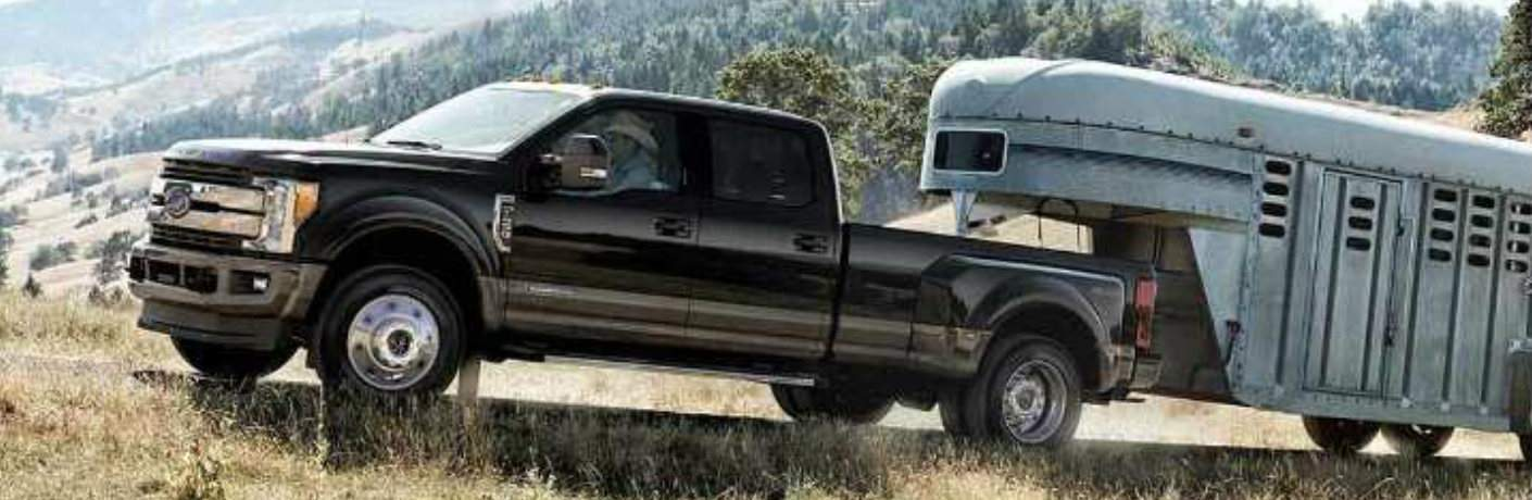 2018 Ford F-350  hauling a silver trailer up a mountain