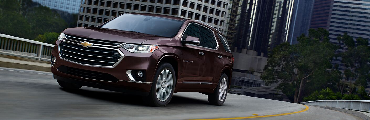 2019 Chevy Traverse cruising down city road