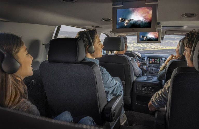 Kids watching the rear-seat entertainment system in the 2019 Chevy Tahoe