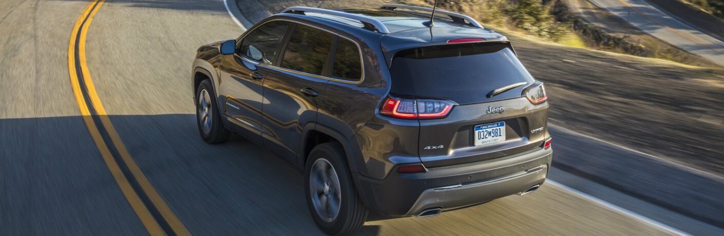 2019 Jeep Cherokee model driving on a windy mountain road