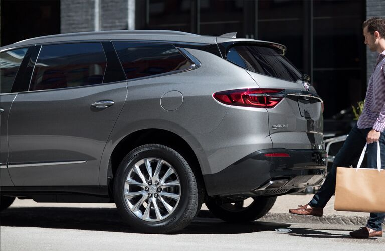 2020 Buick Enclave with man opening hatch with foot