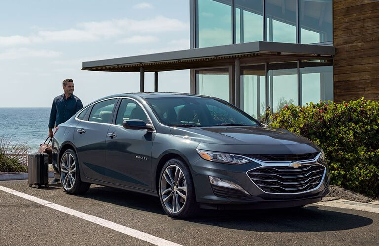 2020 Chevrolet Malibu parked in front of glass house