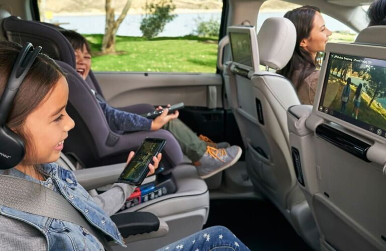 Kids enjoying a movie in the second row of a 2020 Chrysler Pacifica
