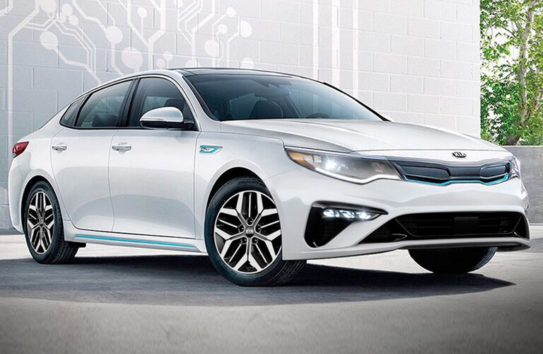 2020 Kia Optima parked in front of white brick building