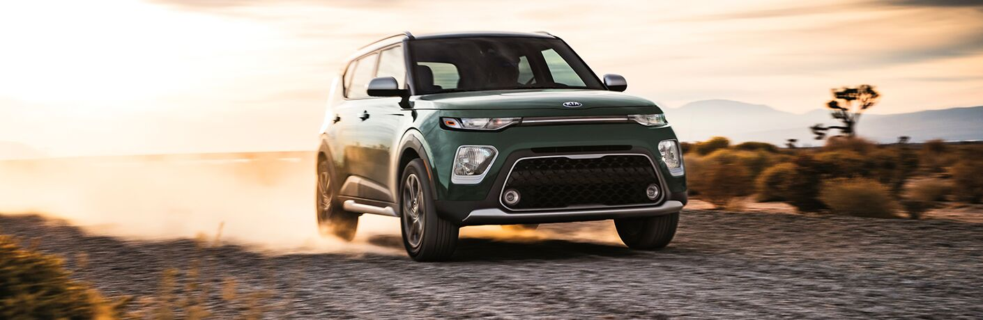 2020 Kia Soul driving in the desert at sunset
