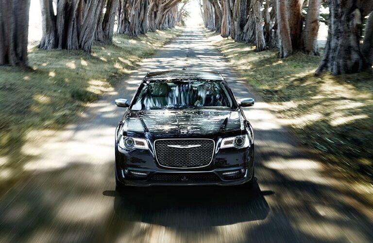 2020 Chrysler 300 going down wooded street