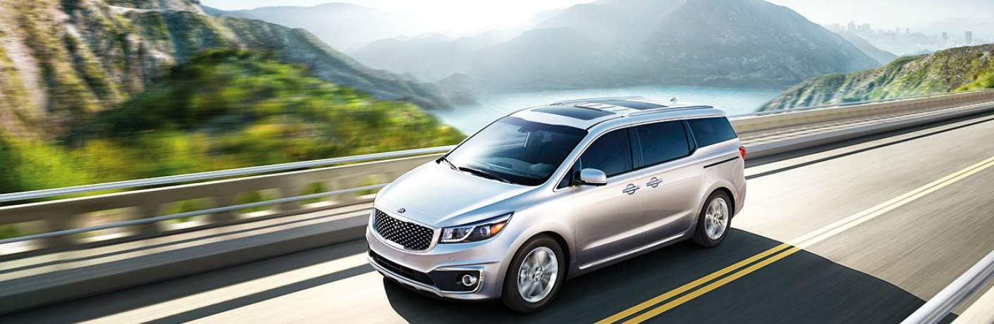 2019 Kia Sedona Driving by Mountains
