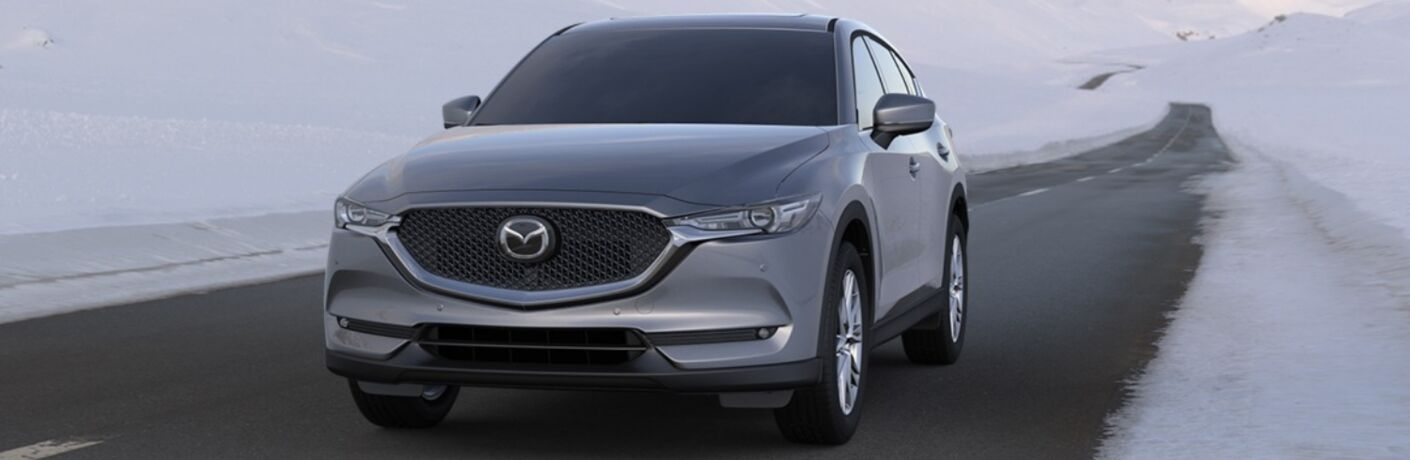 2020 Mazda CX-5 driving down road with ice on both sides