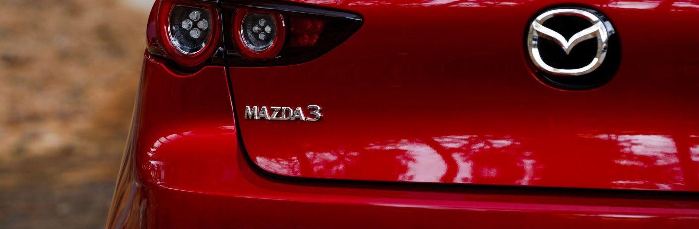 A photo of the Mazda3 badge on the 2019 Mazda3 Hatchback.