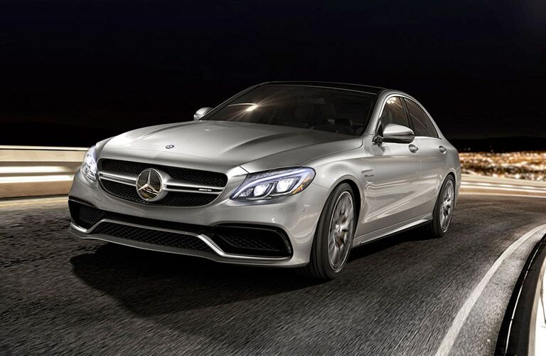 2017 Mercedes-Benz C-Class exterior front fascia drivers side going fast on city road at night