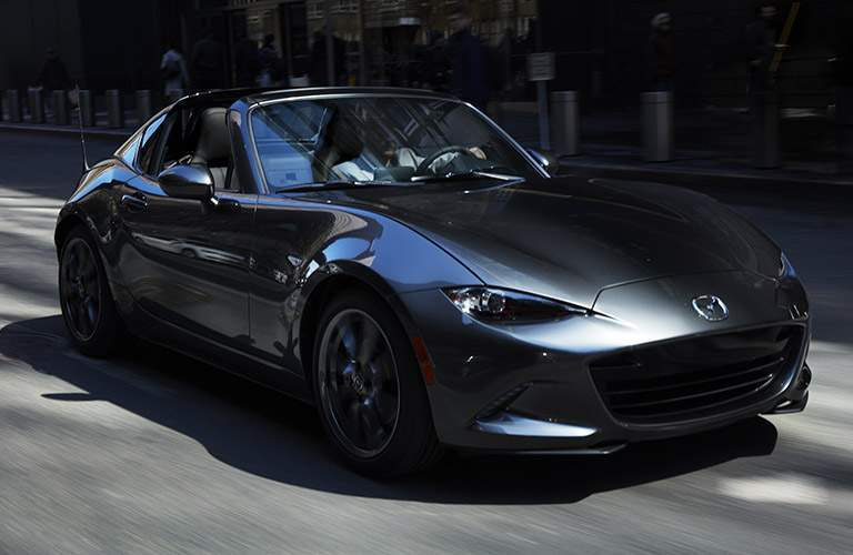 Mazda MX-5 Miata RF driving on a road