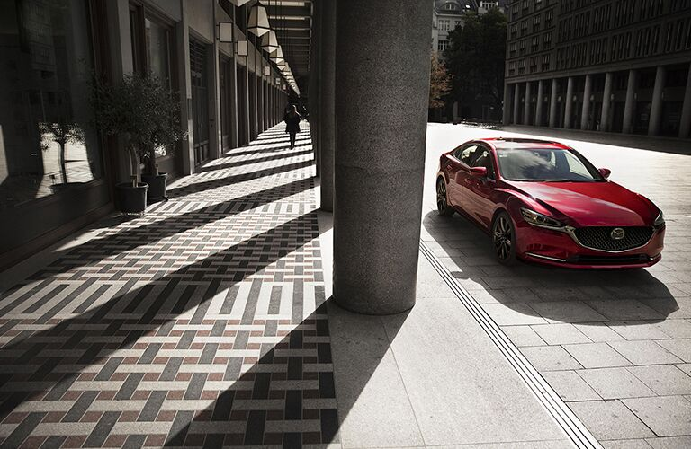 2018 Mazda6 parked next to a pillar in the sun