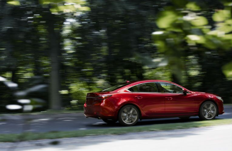 2018 Mazda6 driving past a forest