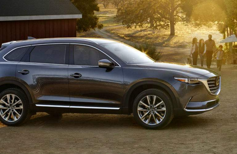 2018 Mazda CX-9 parked with family