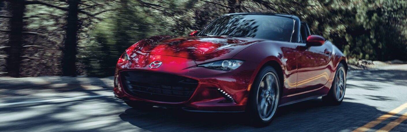 2020 Mazda MX-5 Miata driving on a road
