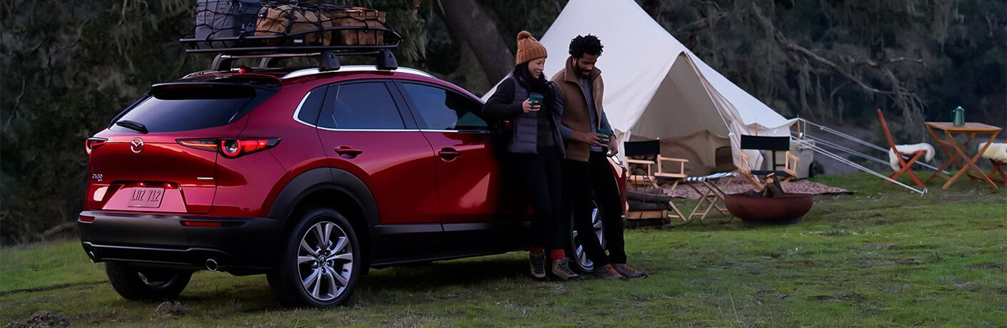 2021 Mazda CX-30 parked next to a tent