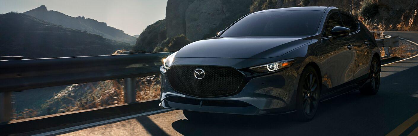 2021 Mazda3 Hatchback driving on a road