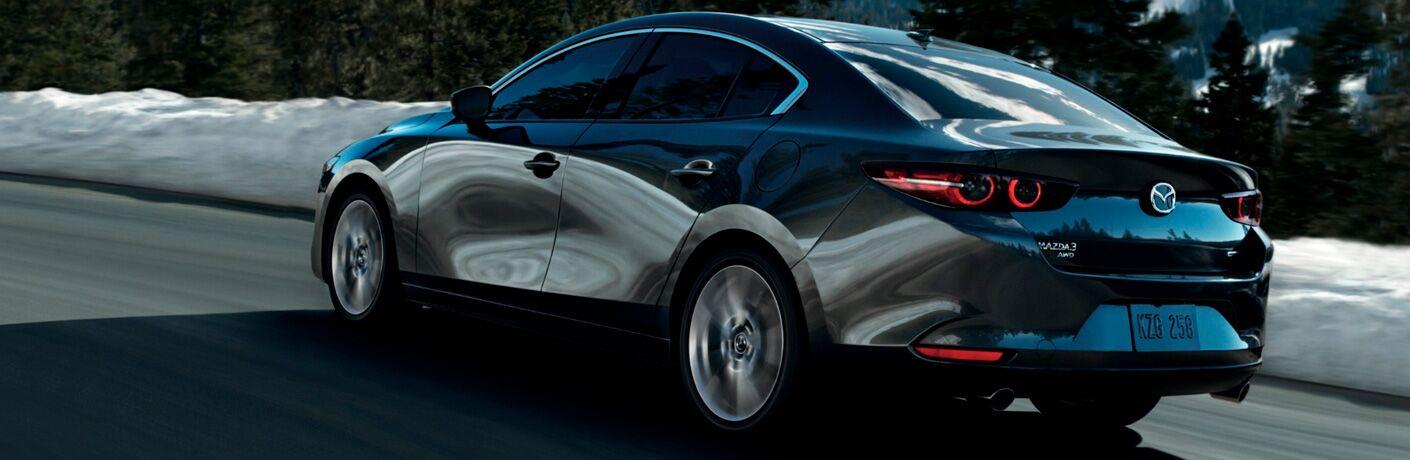 2021 Mazda3 Sedan driving on a road