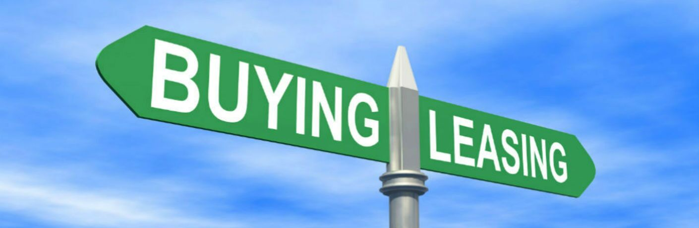 A sign with buying pointed one way and leasing pointed another way