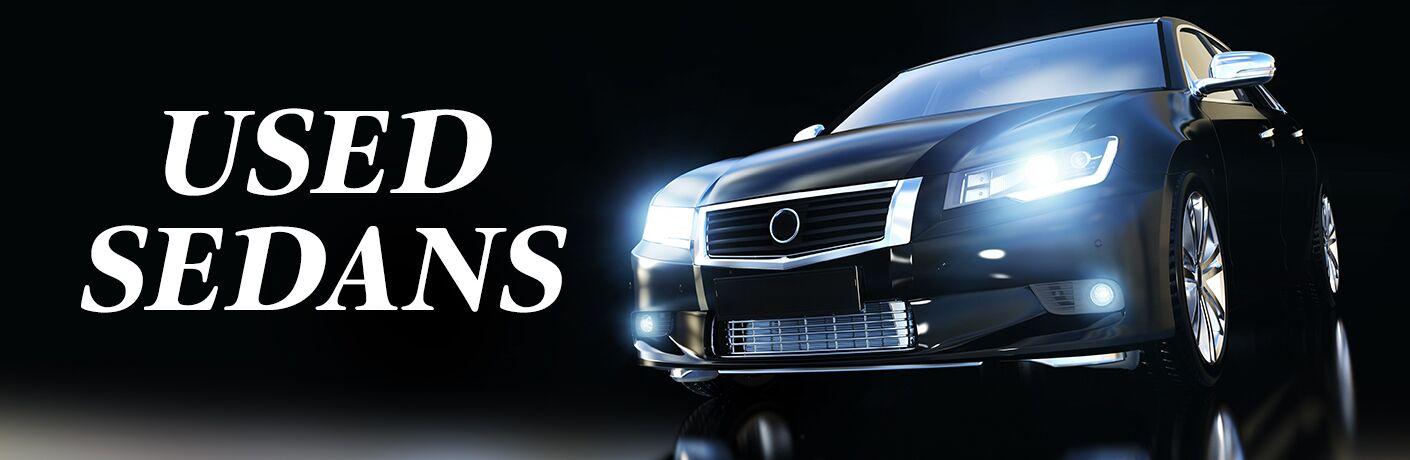 Genaric Used Sedans banner with sedan with headlights on