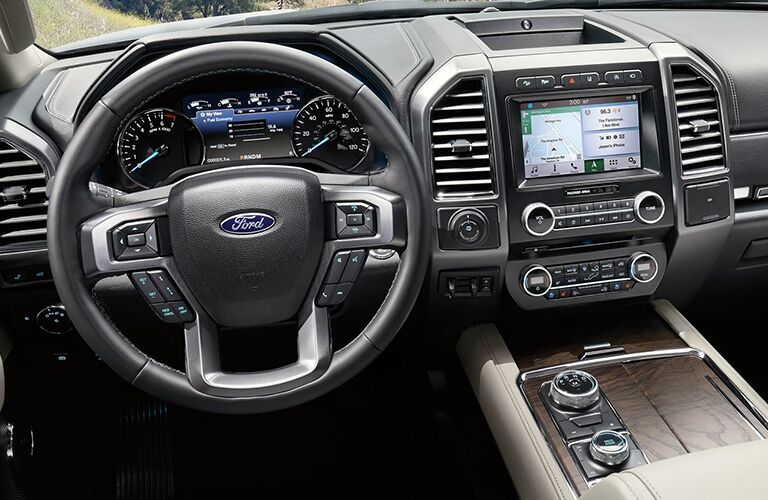 Interior view of the steering wheel, instrument cluster, and touchscreen inside a 2019 Ford Expedition