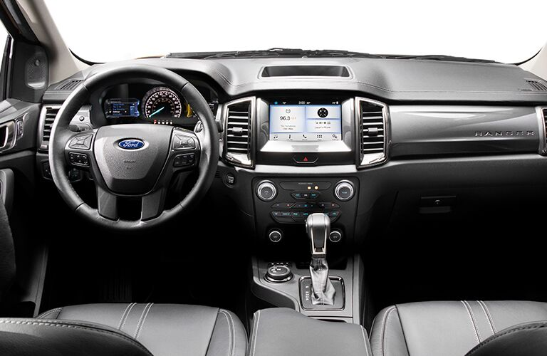 2019 Ford Ranger interior shot of front seating, steering wheel, transmission, and dashboard layout and infotainment screen