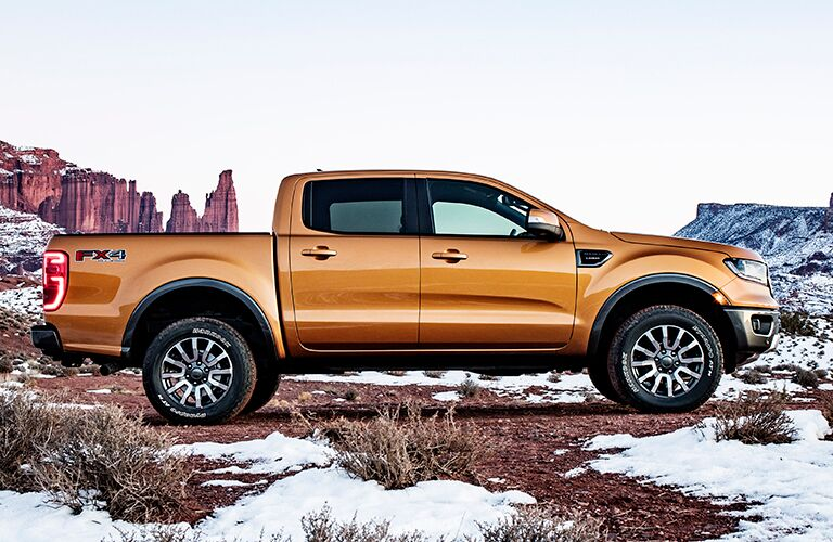 2019 Ford Ranger exterior side shot with golden brown paint color parked near mountains with a fresh snowfall around