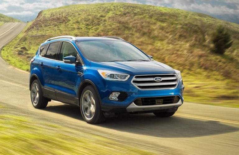 blue ford escape on rural road