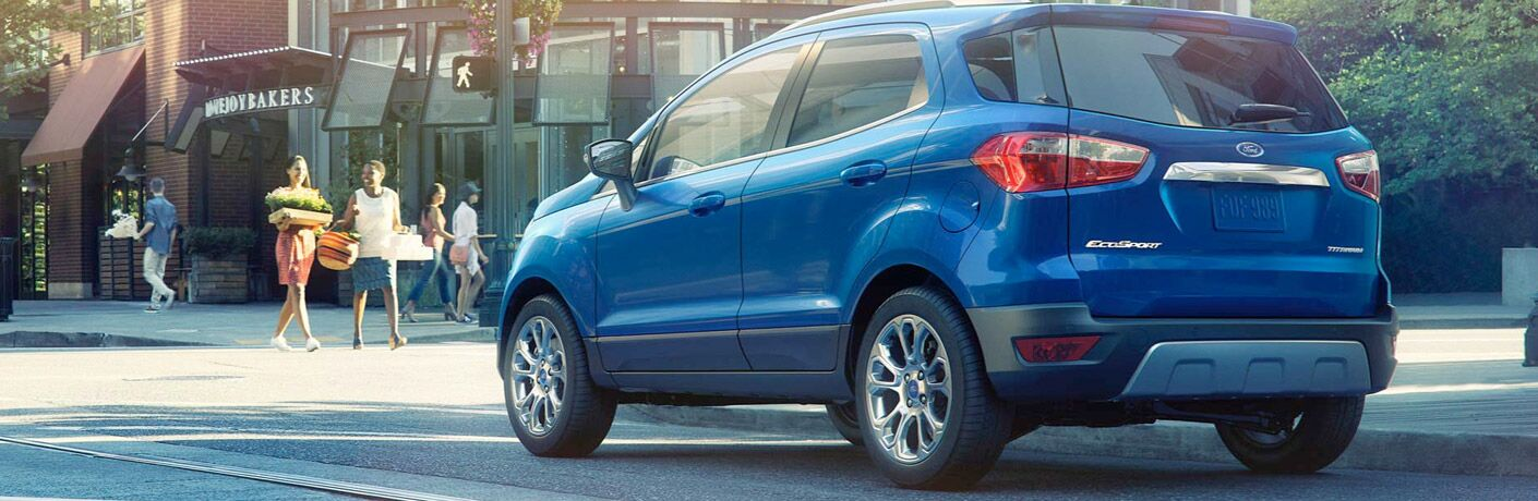 Blue 2018 Ford EcoSport driving on city road