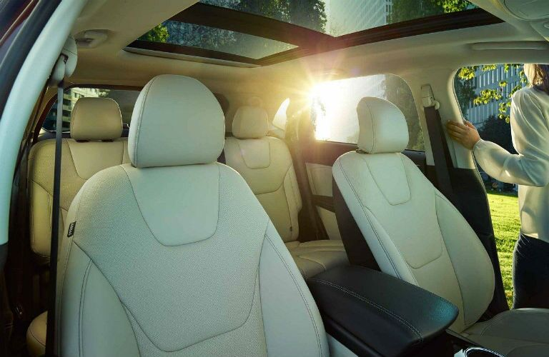 2018 Ford Edge white interior with woman exiting driver side