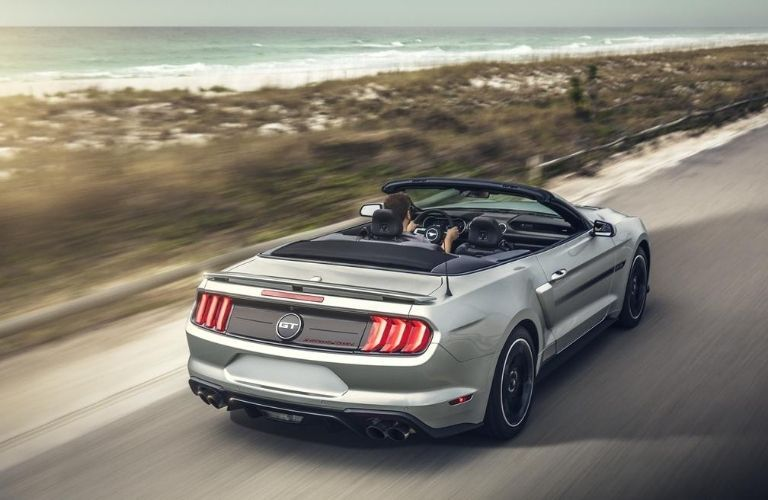 2020 Ford Mustang driving on the road rear view