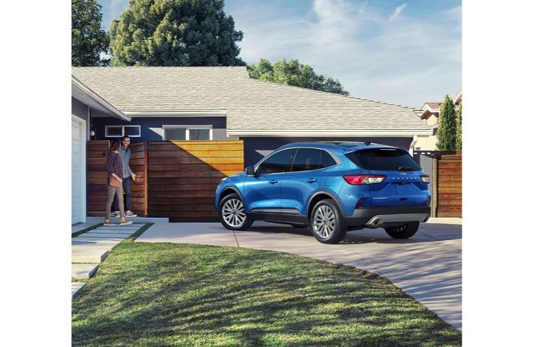 2020 Ford Escape outside a family home
