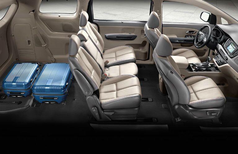 Rear seat of 2018 Kia Sedona folded down to reveal cargo volume