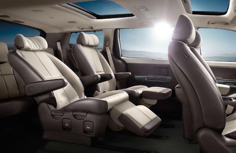 Second row of reclining seats inside 2018 Kia Sedona