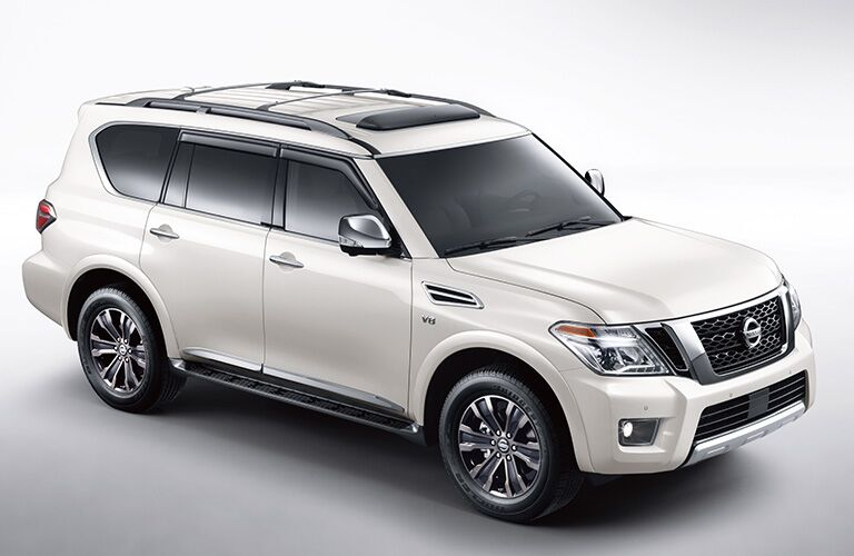 White 2019 Nissan Armada parked in a white void. Exterior raised side/front angled view.