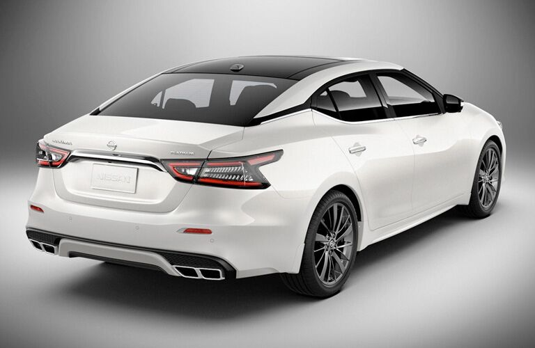 White 2019 Nissan Maxima side angled rear view.