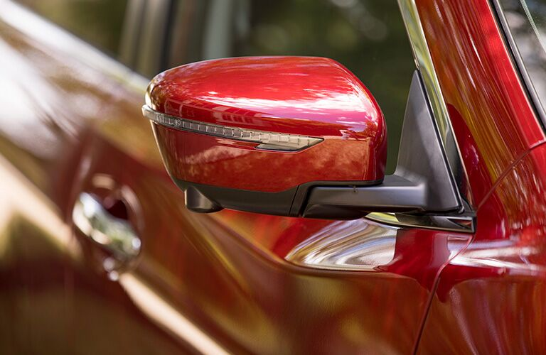Close Up of Red 2019 Nissan Rogue Side Mirror with Integrated Turn Signal