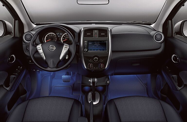 Interior front of 2019 Nissan Versa Sedan, showcasing cabin, dashboard, and front visibility.