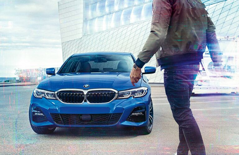 2019 BMW 3 Series with person walking to it