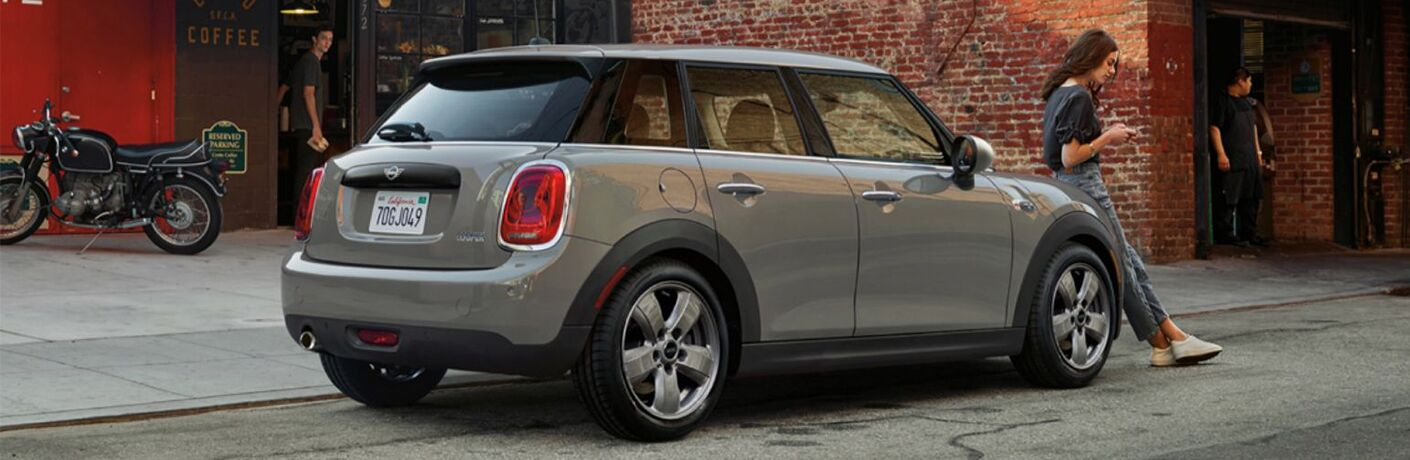 2017 MINI Cooper with woman leaning on it
