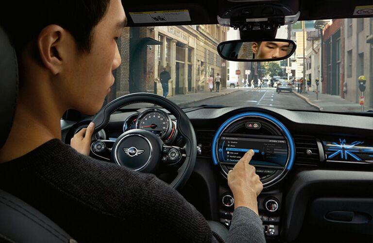 man using touchscreen in 2017 MINI Cooper