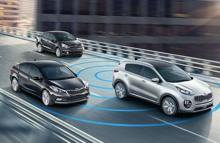 Three 2018 Kia Sportage vehicles driving on highway together